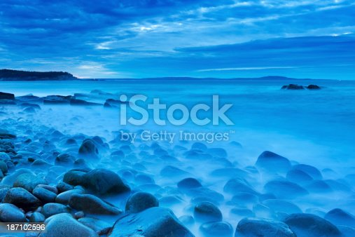 A rocky beach in Acadia National Park, Maine, USA. Photographed during the blue hour before sunrise.