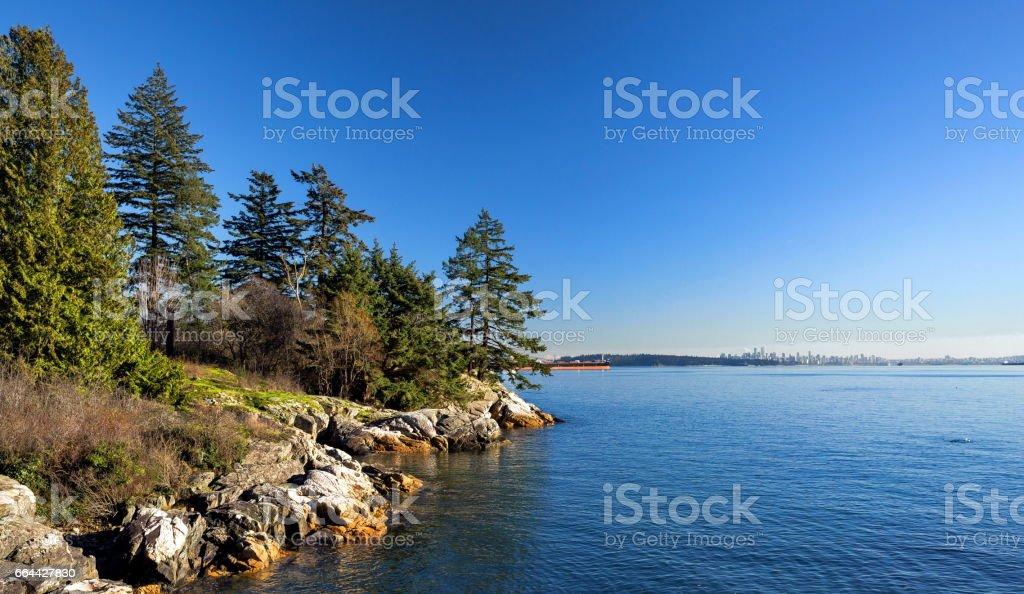 Rocky  beach in the Strait of Georgia stock photo