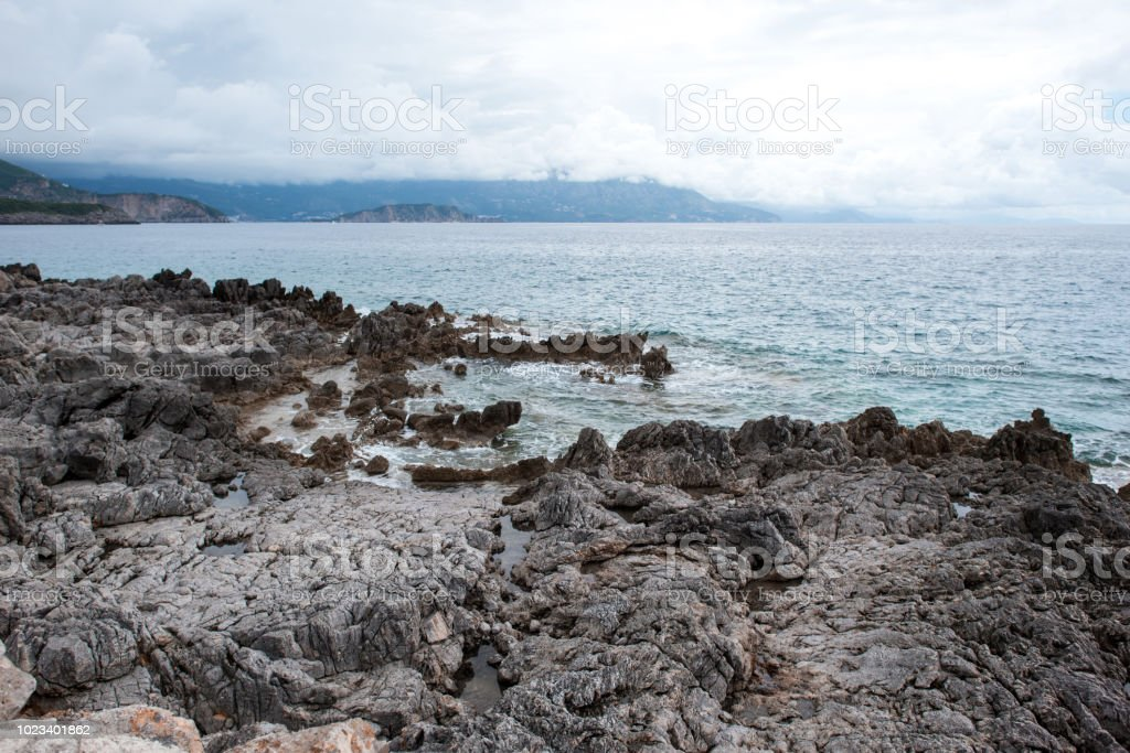 rocky beach of adriatic sea in Montenegro stock photo