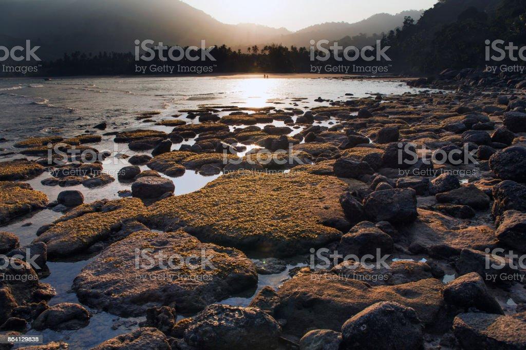 Rocky beach of Tioman Island at sunset royalty-free stock photo