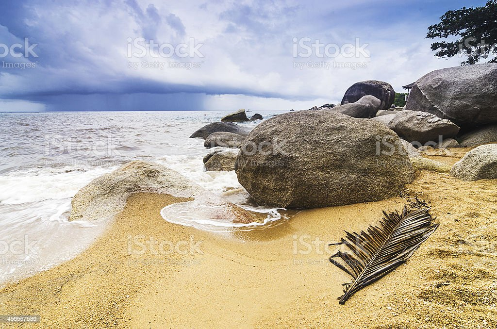 Rocky beach stormy background wallpaper stock photo