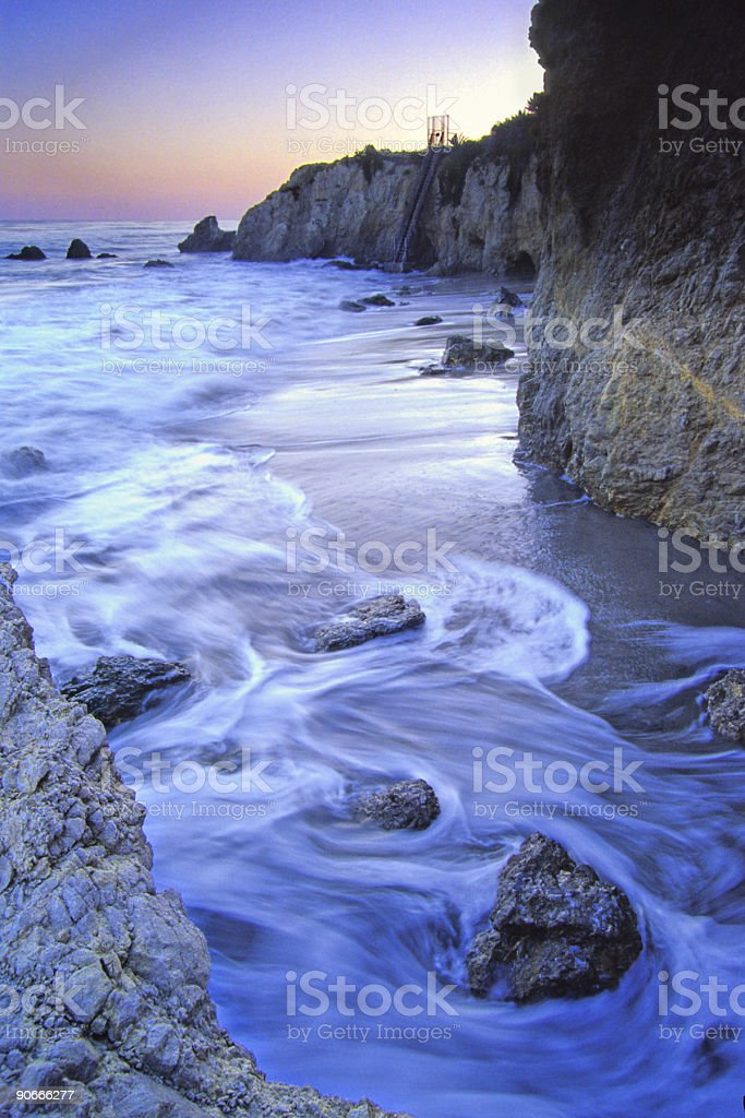 rocky beach sunset royalty-free stock photo