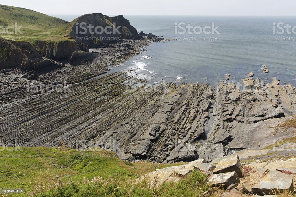 Rocky beach with lined rock strata stock photo