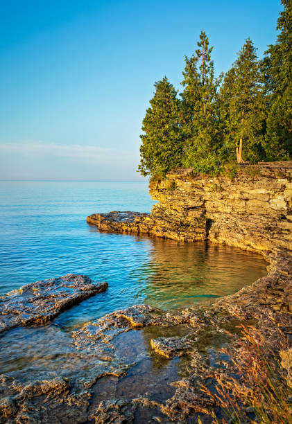 Rocky Cliff at Cave Point on Lake Michigan stock photo