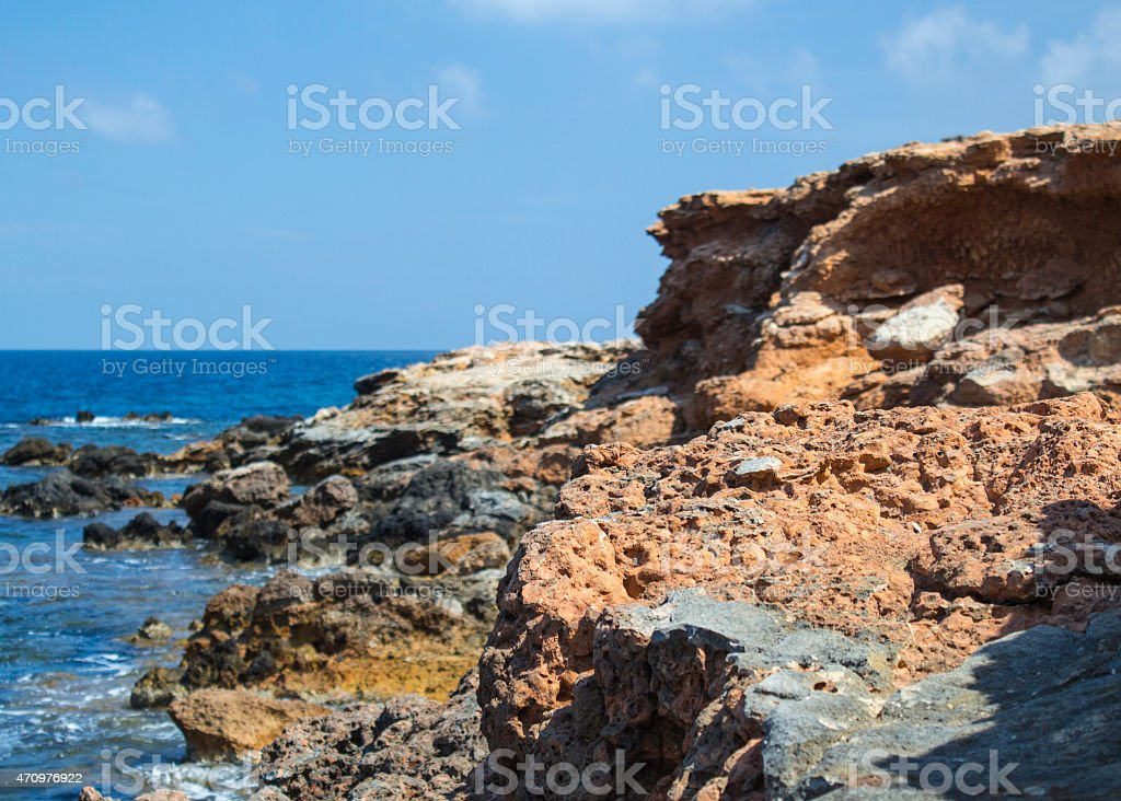 Rocky cliff in Ibiza stock photo