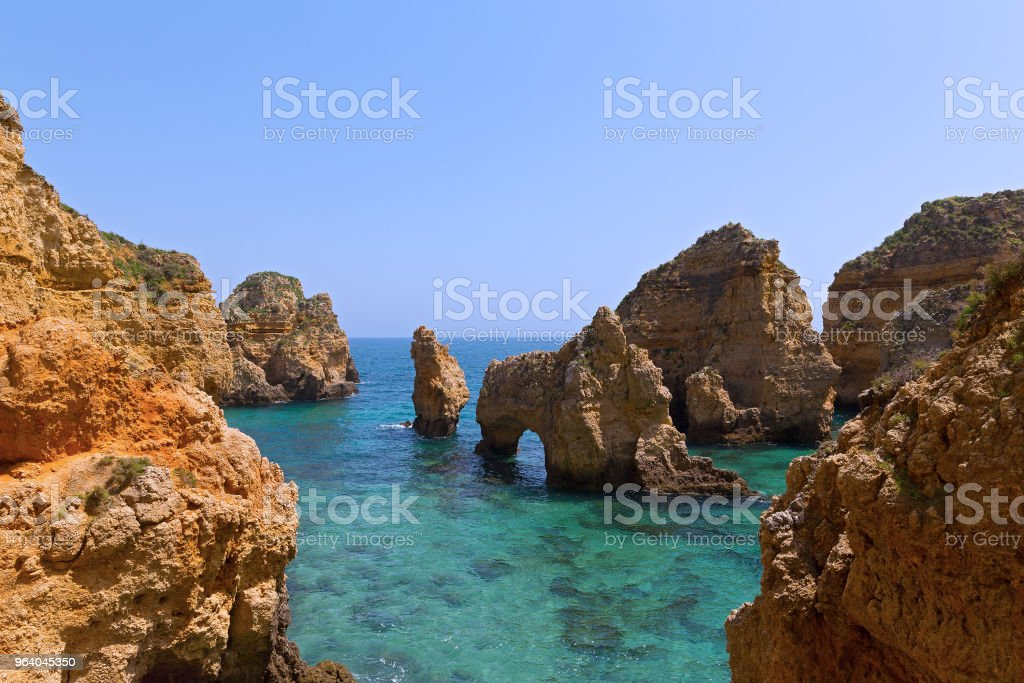 Rocky cliffs and grottoes in Algarve, Portugal. - Royalty-free Algarve Stock Photo