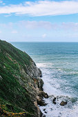 waves crushing against the rocky cliffs in California, near Santa Cruz.
