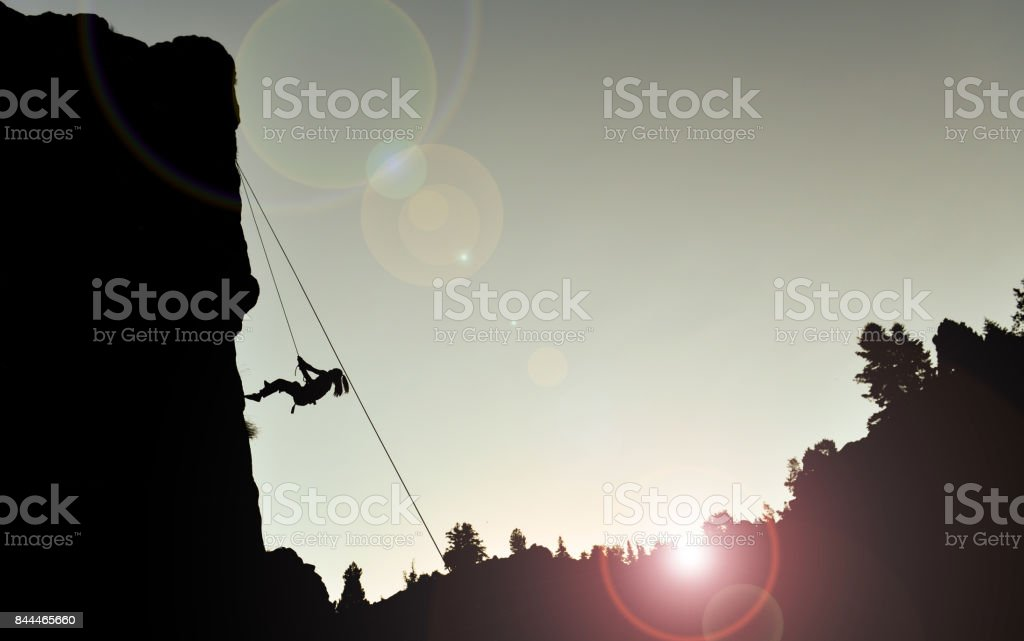 Rocky climber silhouette stock photo