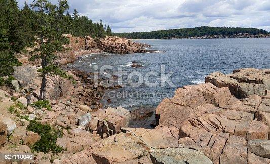 Sheer cliffs and large granite boulders form the shoreline of Mount Desert Island in Acadia National Park.