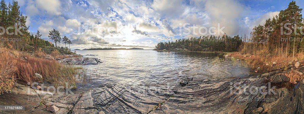Rocky coast of autumn lake royalty-free stock photo