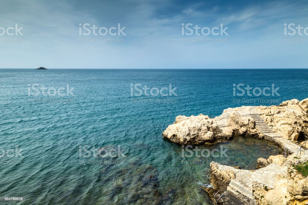 Rocky coast of the Adriatic Sea at Rovinj town in Croatia. royalty-free stock photo