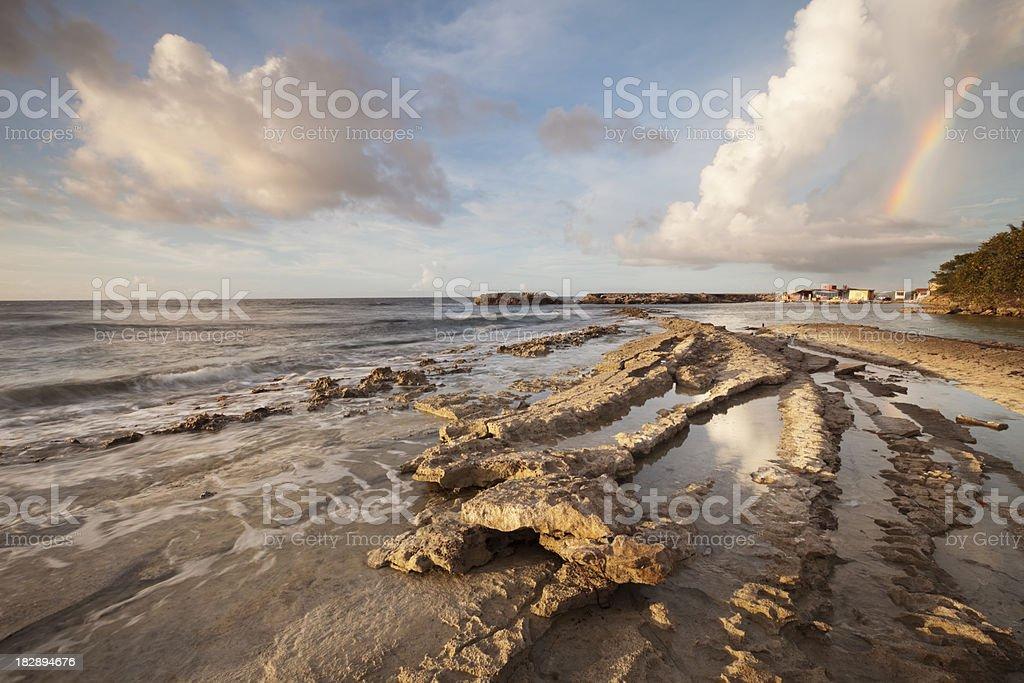 Rocky coast on the island of Curaçao at sunset stock photo