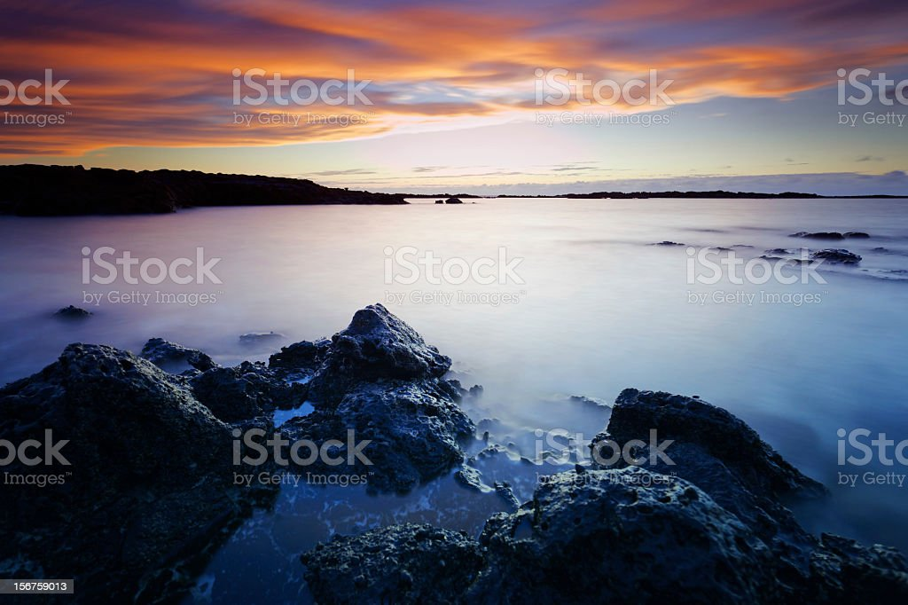 Rocky coast sunset royalty-free stock photo