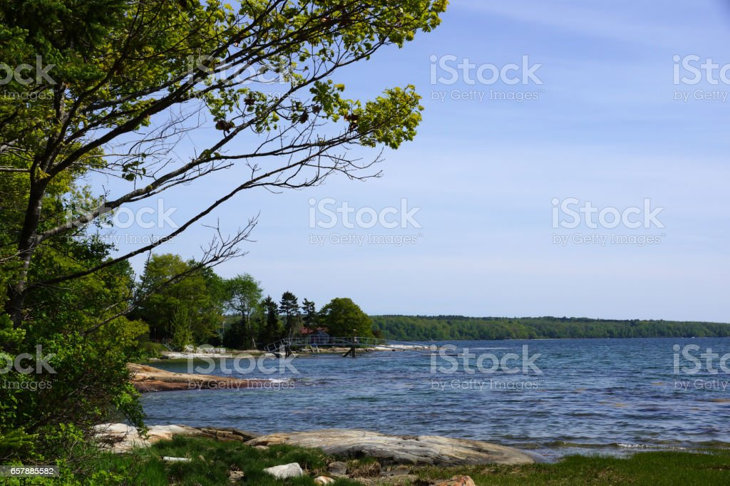 Rocky coast with pier on Littlejohn Island stock photo