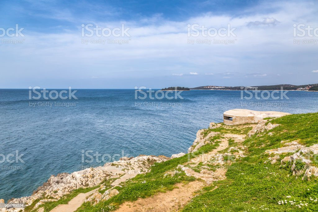 Rocky coast with shelter in Rovinj at the Adriatic Sea, Croatia, royalty-free stock photo