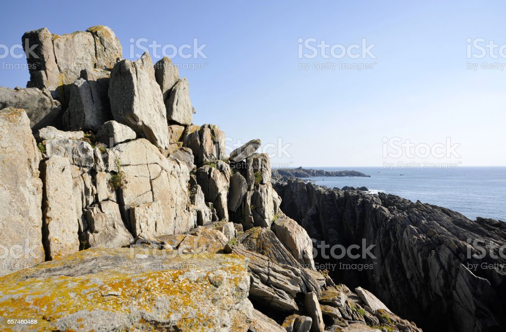 Rocky coastal cliff view on Ile d'Yeu, France; sunny. stock photo