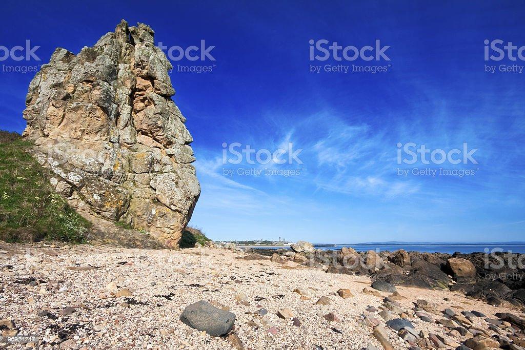 Rocky coastal scene with blue sky royalty-free stock photo