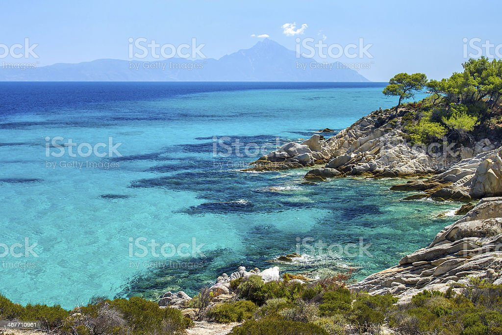Rocky coastline and a beautiful clear water at Halkidiki Kassand stock photo