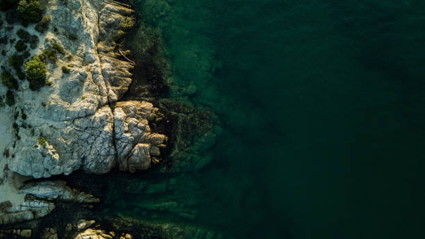 Rocky coastline and sea Rocky coastline and sea, copy space, drone point of view. rocky coastline stock pictures, royalty-free photos & images