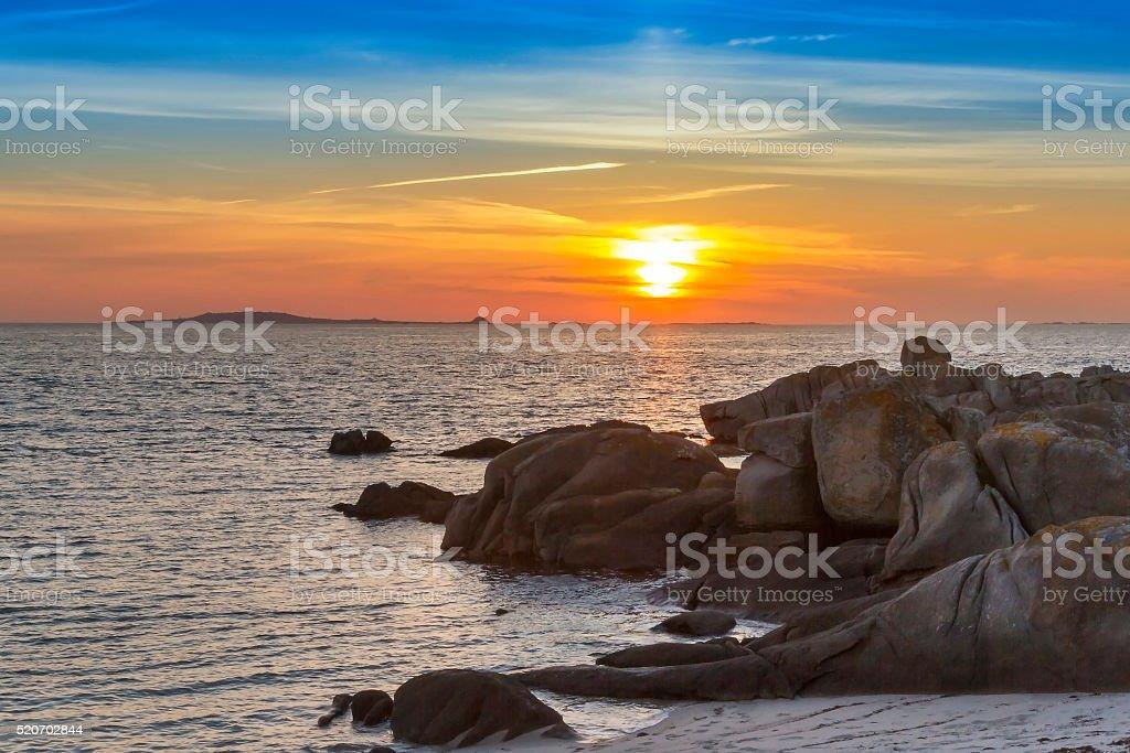 Rocky coastline at sunset royalty-free stock photo