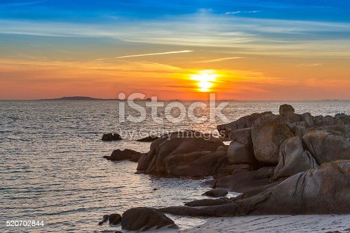 Rocky Coastline At Sunset Stock Photo & More Pictures of Beach