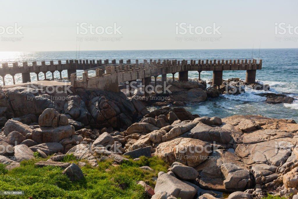 Rocky Coastline Fishing Jetty Ocean Horizon stock photo