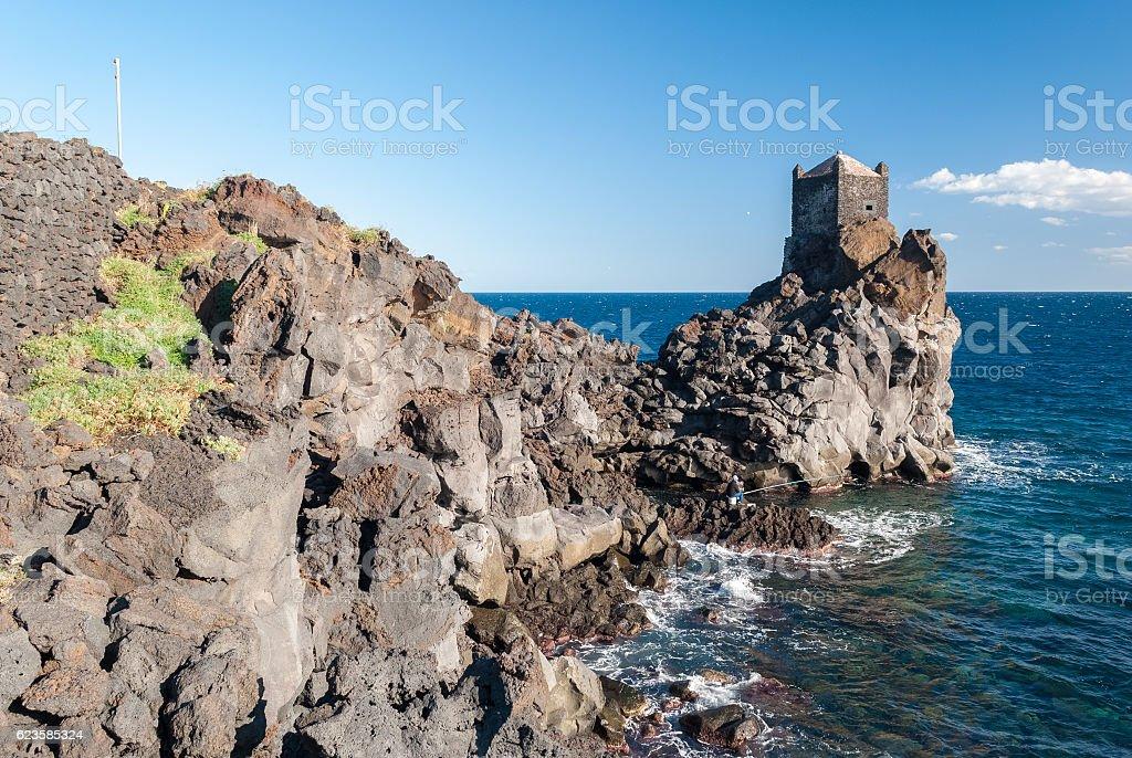 Rocky coastline of lava cliff near Acireale (Sicily) - foto stock