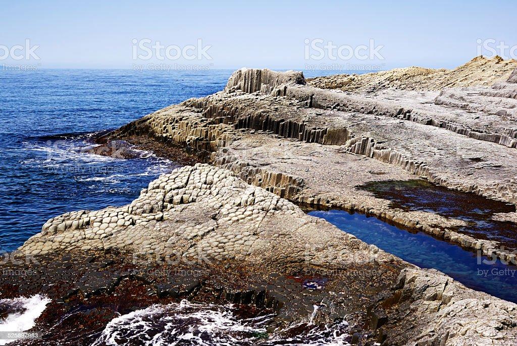 Rocky coastline sea water stock photo