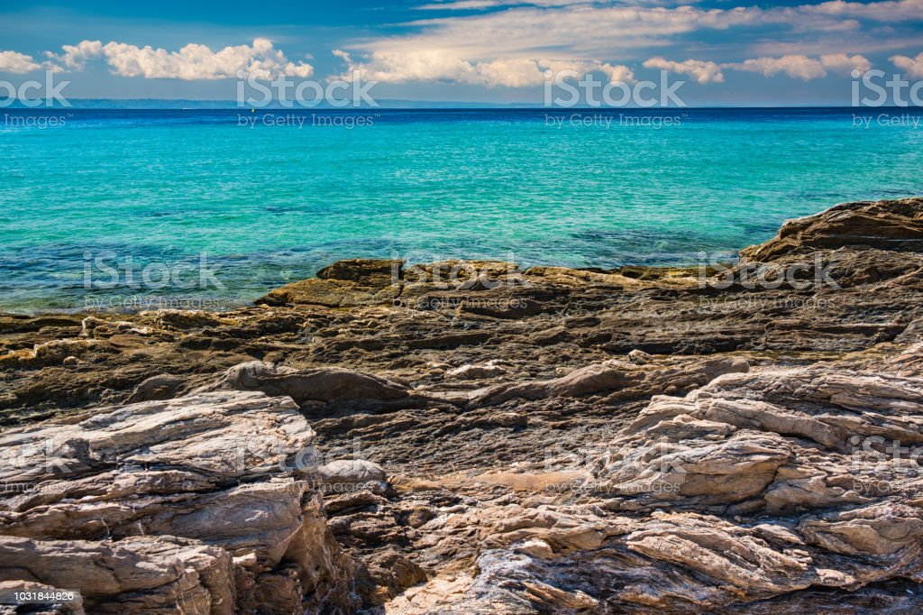 Rocky coastline with clear turquoise sea stock photo
