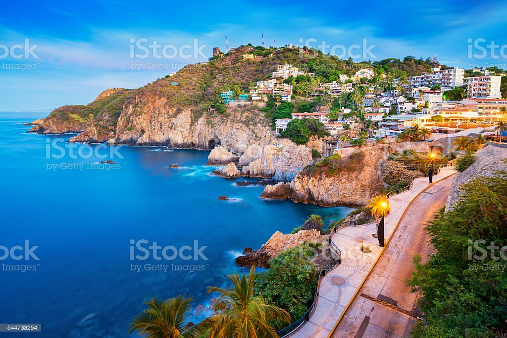 Rocky Coastline with Promenade in Acapulco Mexico stock photo