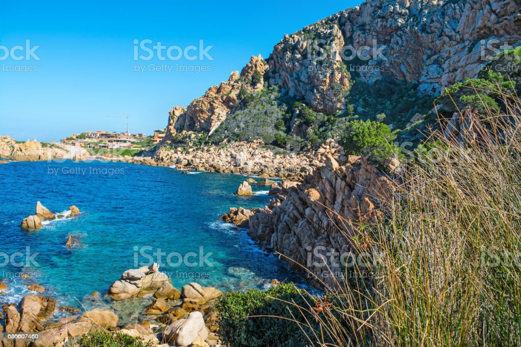 Rocky cove and blue water royalty-free stock photo