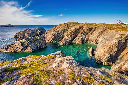 Rocky cove and lighthouse at Cape Bonavista, Newfoundland, Canada