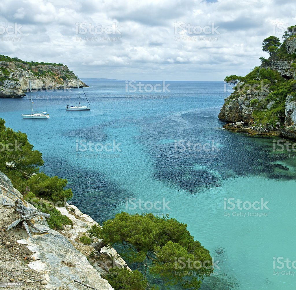 rocky cove in Minorca royalty-free stock photo