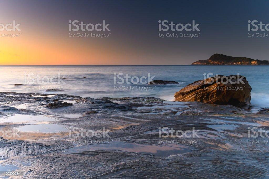 Rocky Dawn Seascape stock photo