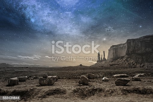 view of a rocky desert landscape at dusk