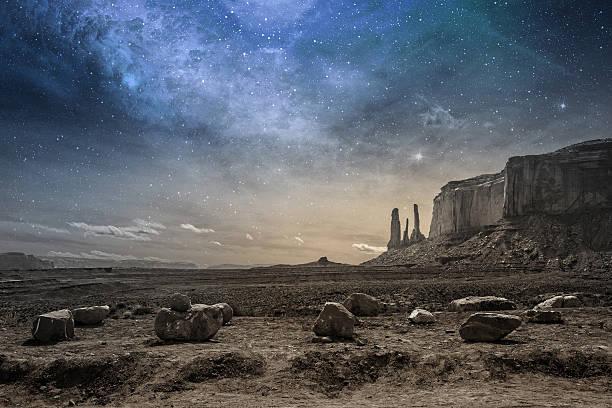 rocky desert landscape at dusk stock photo