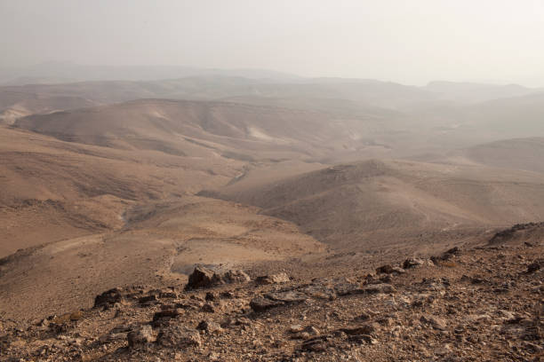 Rocky desert landscape background. Rocky desert hills background in the Negev Desert, Israel, Middle East. negev stock pictures, royalty-free photos & images