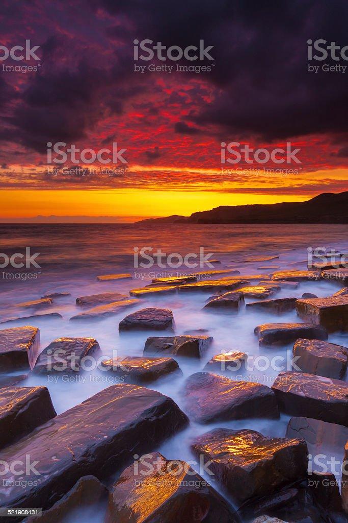 Rocky Dorset Coastline at sunset stock photo