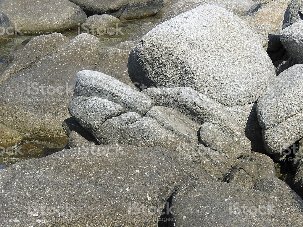 Rocky figure on beach royalty-free stock photo