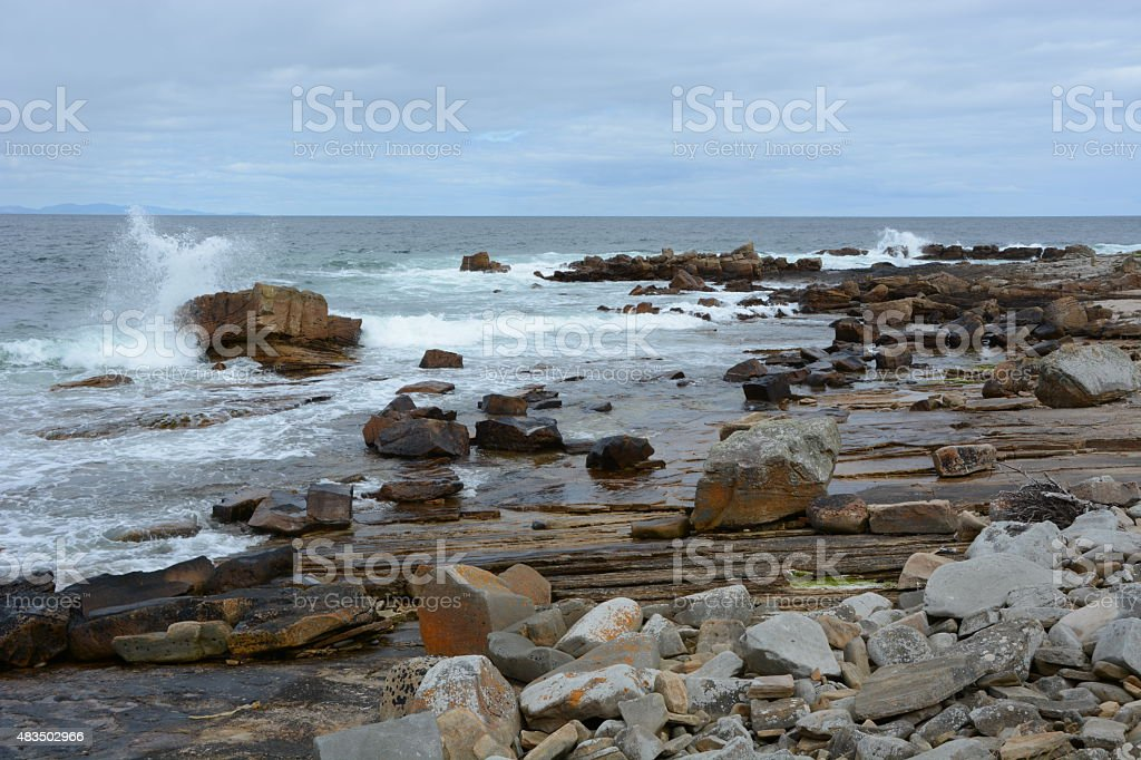 Rocky Foreshore with White Spray Witch stock photo