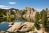 'Black Hills landscape- a beautiful Sylvan Lake with granite hills and pine trees surrounding it on a sunny, summer day; South Dakota'