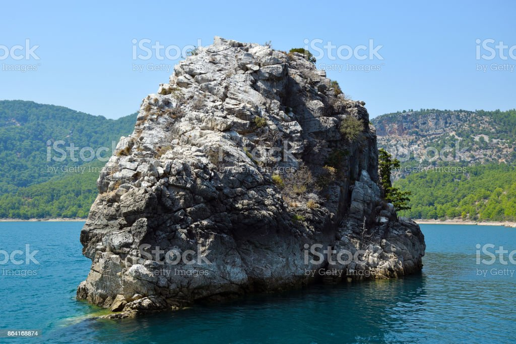 A rocky island in a green canyon. royalty-free stock photo