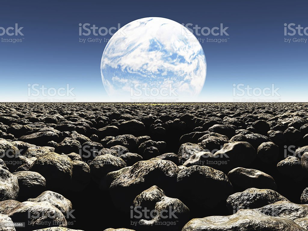 Rocky Landscape with planet or earth stock photo