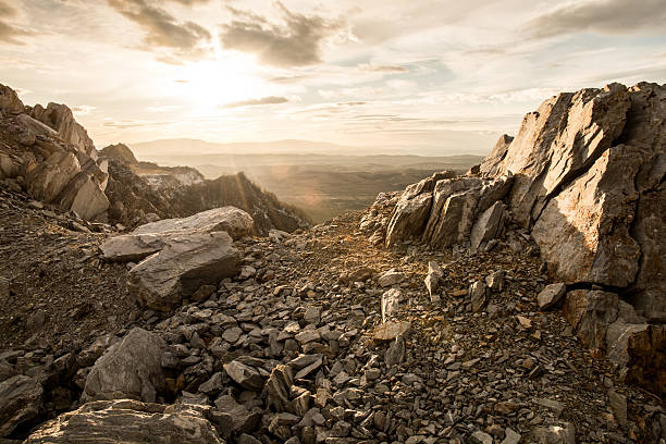rocky mountain and sunset - atmospheric mood stock photos and pictures