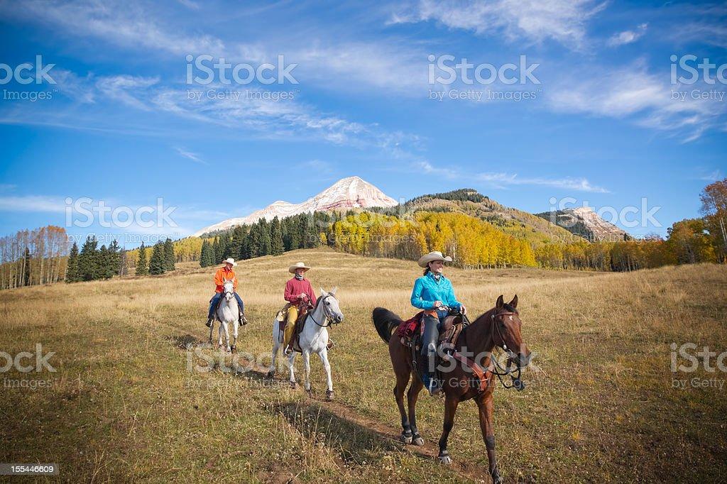 rocky mountain horseback landscape stock photo