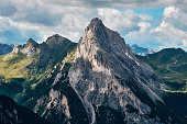 A rocky mountain peak with hiking trails next to the Marmolada Glacier  in the Trentino Dolomites, Italy