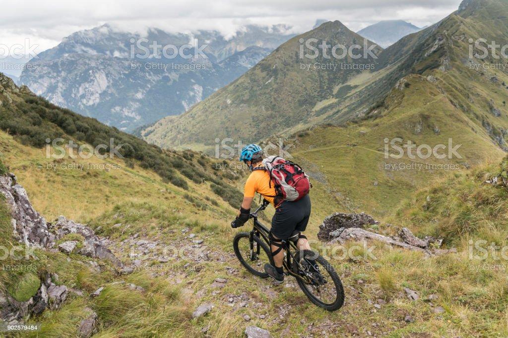 Rocky mountainbike downhill in the Friulian Mountains, Italy stock photo