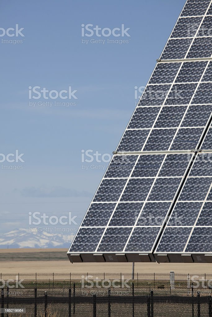 Rocky Mountains and solar collectors in Aurora Colorado royalty-free stock photo