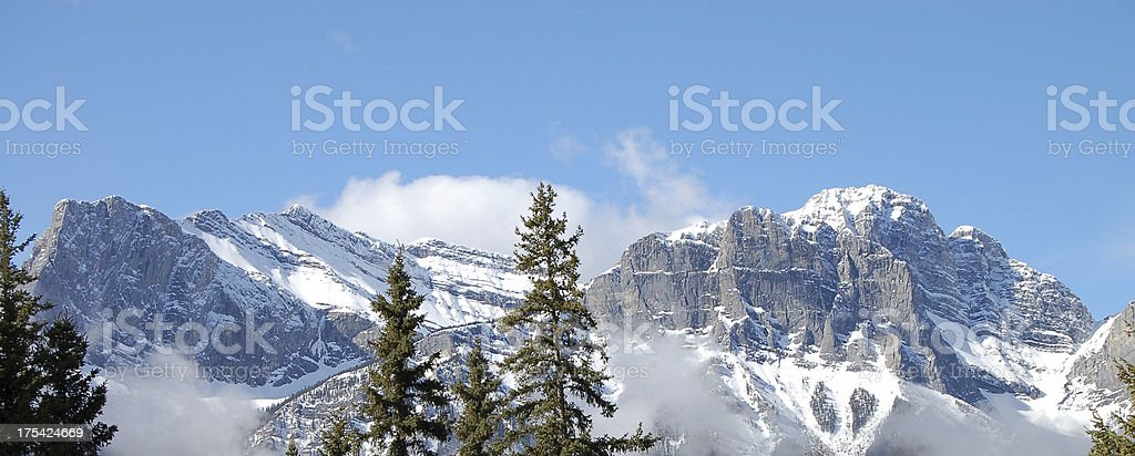Rocky Mountains beside Three Sisters Landmark royalty-free stock photo