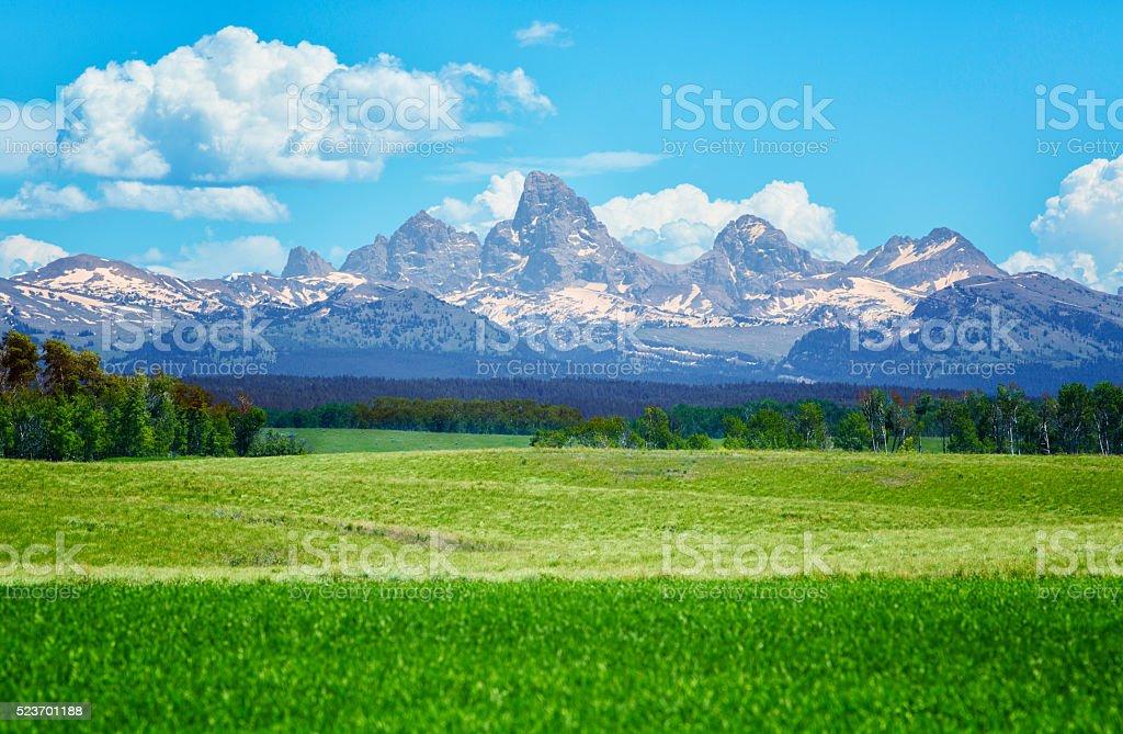 Rocky mountains over Idaho fields stock photo
